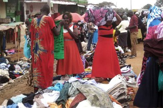 'US threats force EAC to back down on secondhand clothes ban' - Article